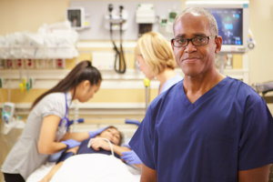 portrait of male nurse working in emergency room