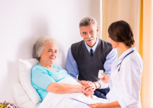 caring for a sick senior women in hospital